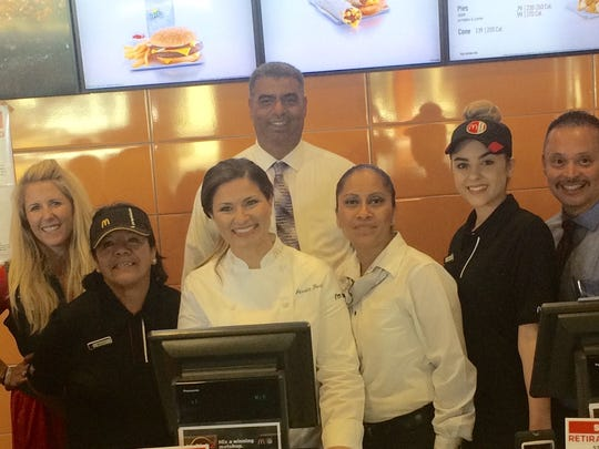 McDonald's Chef Jessica Foust, center and in front of cash register, with staff at the McDonald's in Greenfield during the filming.