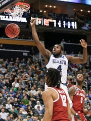 Villanova's Eric Paschall (4) dunks over Alabama's Dazon Ingram (12) during the second half of a second-round game in the NCAA men's college basketball tournament, Saturday, March 17, 2018, in Pittsburgh. Alabama won 81-58. (AP Photo/Keith Srakocic)