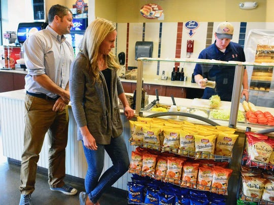 Chris Rampone (left) and Christie Rampone (right) are shown at the Jersey Mike's location in Red Bank.