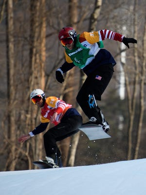 Mark Mann USA (L) and Mike Schultz USA competes during the Men's Snowboard Cross Quarterfinal SB-LL1 at the Jeongseon Alpine Centre. The Paralympic Winter Games, PyeongChang, South Korea, Monday 12th March 2018. Photo: Joel Marklund for OIS/IOC. Handout image supplied by OIS/IOC