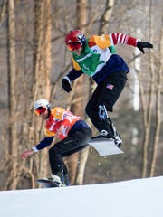 Mark Mann USA (L) and Mike Schultz USA competes during the Menís Snowboard Cross Quarterfinal SB-LL1 at the Jeongseon Alpine Centre. The Paralympic Winter Games, PyeongChang, South Korea, Monday 12th March 2018. Photo: Joel Marklund for OIS/IOC. Handout image supplied by OIS/IOC