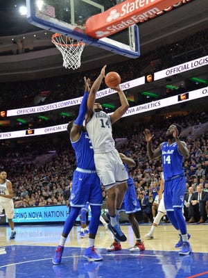 Villanova forward Omari Spellman (14) drives against Seton Hall center Angel Delgado.