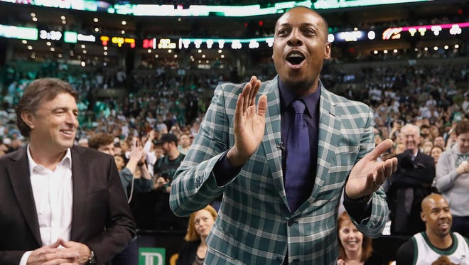 Former Boston Celtics forward Paul Pierce cheers as team owner Wyc Grousbeck  looks on during the first quarter of Sunday's game against the Cleveland Cavaliers. Pierce had his No. 34 jersey retired before the game.