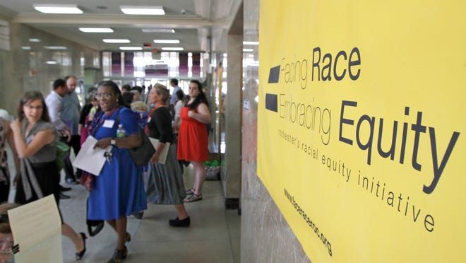 Attendees at the Facing Race = Embracing Equity Community Summit on Race held in May 2013 at East High School.