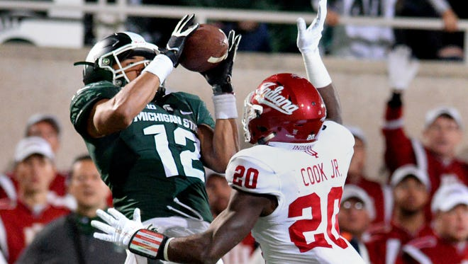 MSU receiver R.J. Shelton grabs a fourth quarter pass in the end zone from Connor Cook past  Indiana's Jameel Cook Jr. on Oct. 24, 2015.