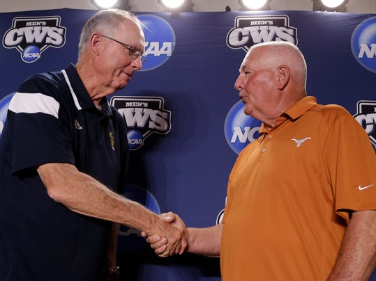 Texas coach Augie Garrido, right, and UC Irvine coach Mike Gillespie shake hands at the conclusion of a coaches news conference, Friday, June 13, 2014, ahead of the NCAA baseball College World Series tournament which starts at TD Ameritrade Park in Omaha, Neb., on Saturday. Texas plays UC Irvine on Saturday. (AP Photo/Nati Harnik)