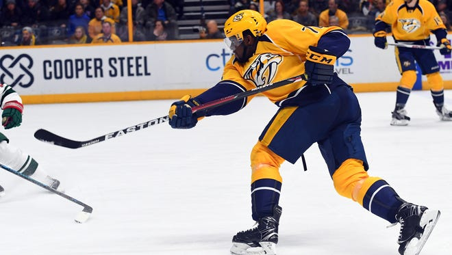Nashville Predators defenseman P.K. Subban (76) attempts a shot against the Minnesota Wild during the third period at Bridgestone Arena.