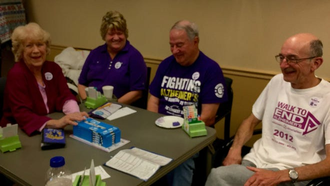 """Bridge For the past four years, the Evansville Duplicate Bridge Club plays bridge from sunrise to sunset on June 21, the longest day of the year, to raise funds for Alzheimer's research.  Game start times take place throughout the day, and the early morning players arrive in their sleep attire.  Fondly referred to as the """"Longest Day"""" event, funds raised benefit the local Alzheimer's Association. Seated from left are Susie Hill, Jane Kempin, Dennis Dewey and Dale Hill."""