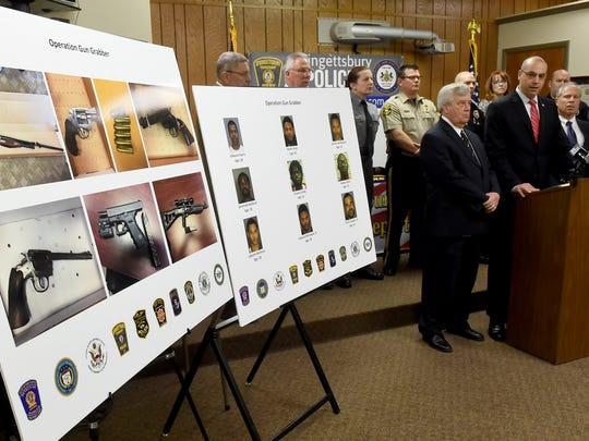 Dave Sunday, the chief deputy prosecutor for the York County District Attorney's office, talks about the nine people indicted for firearms trafficking during a news conference at the Springettsbury Township Police Department on Friday.