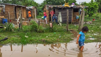 A heavy thunderstorm left water standing in this Ayoreo village near Santa Cruz de la Sierra, Bolivia.