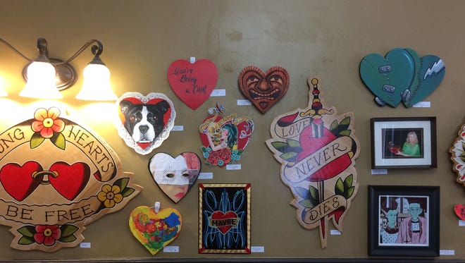 "Poppycock Tattoo & Piercing's ""Sweetheart and Heartache"" art exhibit is open through March 1."
