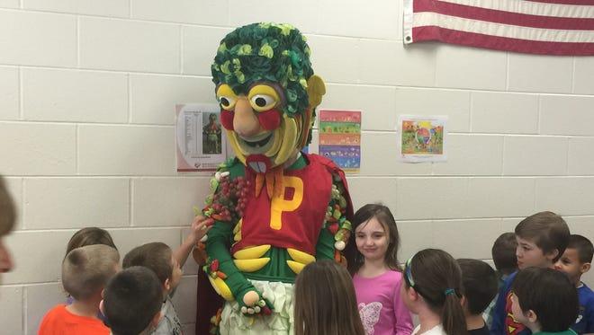 Produce Man talks with the kids at Kelly Elementary School in Burlington, Kentucky.