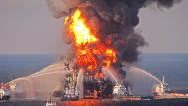 A picture released by the US Coast Guard on 22 April 2010 shows a fire aboard the mobile offshore oil drilling unit Deepwater Horizon, located in the Gulf of Mexico some 80 kilometers southeast of Venice, Louisiana, USA.
