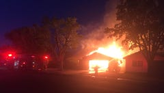 Visalia home goes up in flames