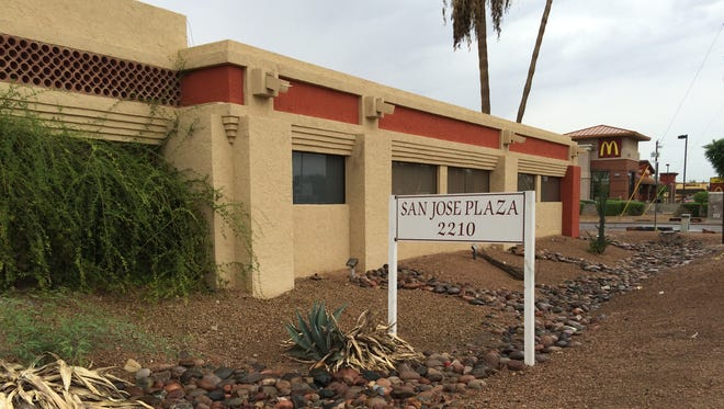 A developer wants to tear down this decades-old office building in Mesa to build a new Starbucks coffee shop.
