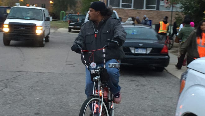 Greg Jackson of the West Side Riders heads out from the Northwest Activities Center Thursday night to patrol during Angel's Night.