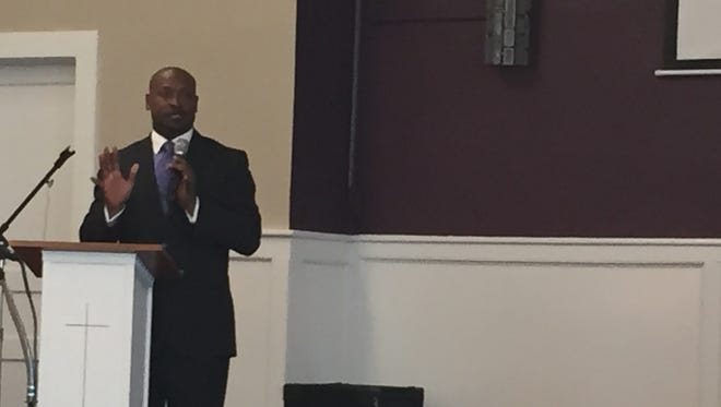 The Rev. James McCarroll speaks at a community meeting at First Baptist Church on East Castle Street in Murfreesboro on Sunday about the arrest of several young students.