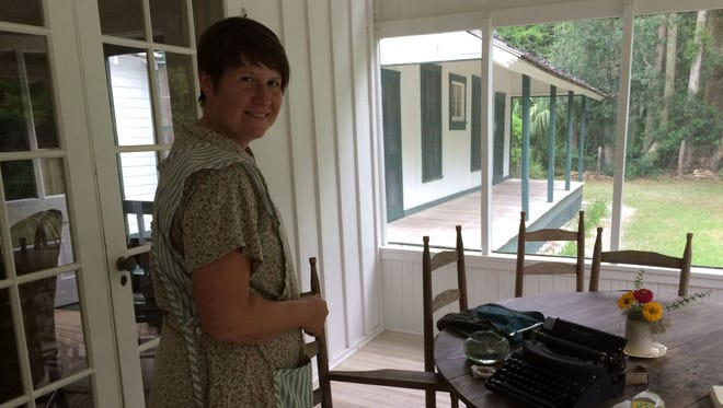 Carrie Todd, park ranger at Marjorie Kinnan Rawlings Historic State Park in Cross Creek, stands on the front porch of the writer's home.