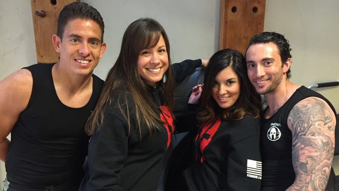 From left, Jeremias Maneiro of Greece, Cyndi Luciano of Irondequoit, Christi Joseph and Vinny Mogavero, both of Greece. The quartet is one of 36 teams featured on the NBC reality show Spartan: Ultimate Team Challenge.