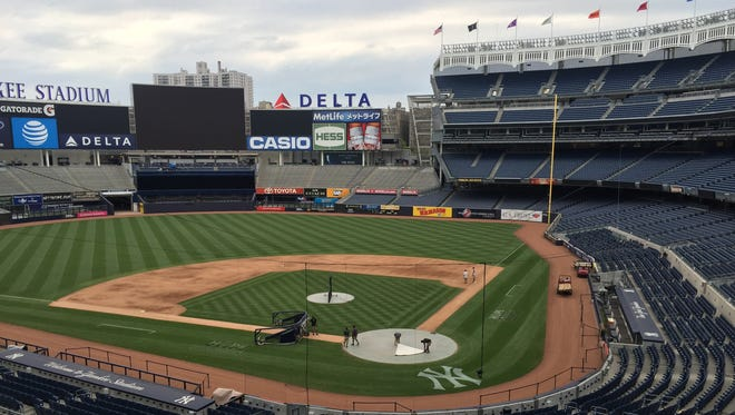 The Yankee Stadium grounds crew prepares the field for batting practice on June 11, 2016.