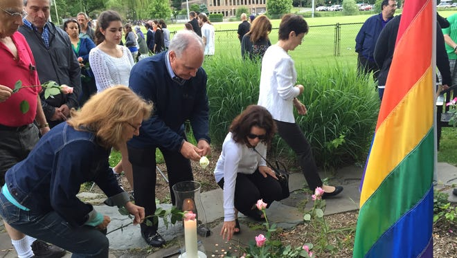 More than 200 people attended a vigil to remember the victims of the Orlando shooting in New Castle on Monday evening.