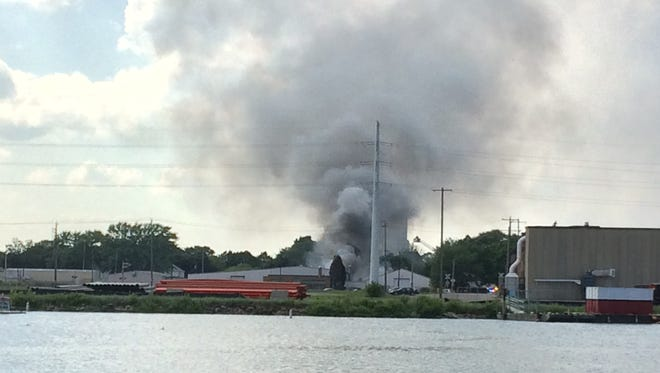A fire on South Broadway is visible from the west side of the Fox River in Green Bay.