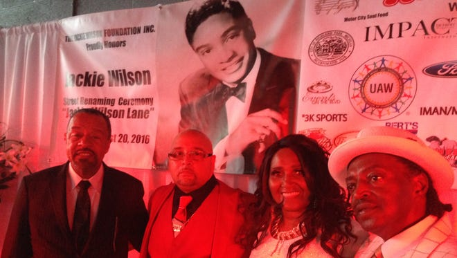 Highland Park Mayor Hubert Yopp (from left) and Jackie Wilson's children, Thor, Brenda, and Anthony Wilson, celebrate the renaming of Cottage Grove Street to Jackie Wilson Lane at a ceremony WHPR TV and radio studios in the city Saturday, Aug. 20, 2016.