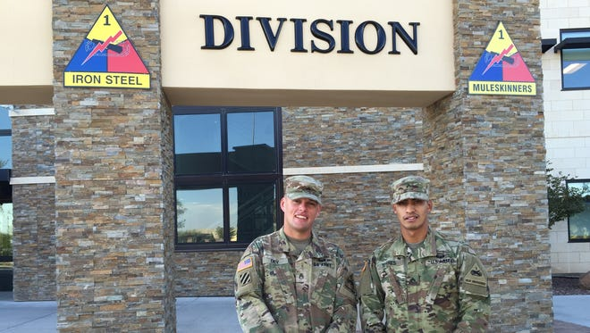 Staff Sgt. Stephen Dey, left, and Cpl. Vicente Torres-Vazquez were named the NCO and Soldier of the Year, respectively, for Fort Bliss and the 1st Armored Division.