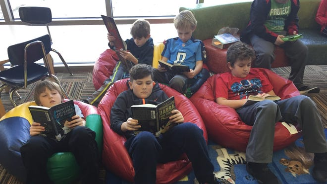 Students in Ryan Miller's third-grade classroom at Prairie Trail Elementary check out new books and enjoy independent reading time in the library. Students pictured in the front row, from left: Carson Bright, Ryan Pruin, Wyatt Sullivan. Back row: Joey Sandvig, Ben Bretthauer, Tobyn Whitten.