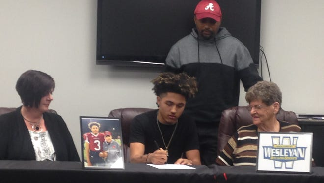 Asheville High senior Devon Davidson has signed to play college football for North Carolina Wesleyan.
