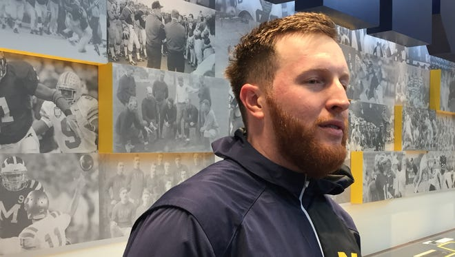 Michigan running backs coach Jay Harbaugh speaks after practice April 13, 2017.