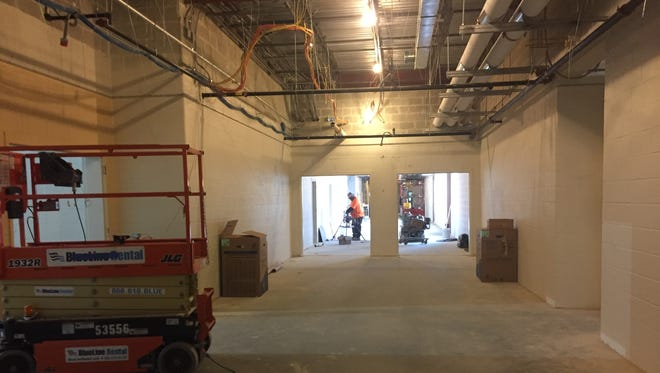 Construction crews working in a corridor of the Lincoln Avenue Middle School.