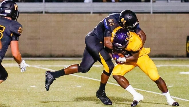 Jaden Crumedy makes a tackle during last years game against Hattiesburg.