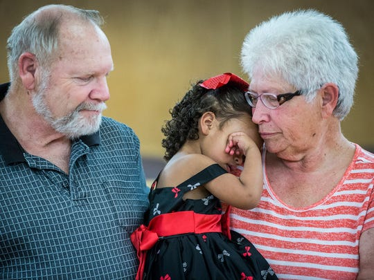 Bob and Harriett Weekley finalize their adoption of Braelynn, 2, during National Adoption Day at the Justice Center Friday afternoon.