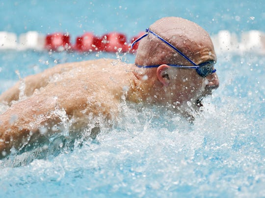 York Suburban's Aidan Fryar swims the butterfly in the 200-yard medley relay in the District 3 Class 2A boys swimming championships last season. The Trojans won second in the relay.