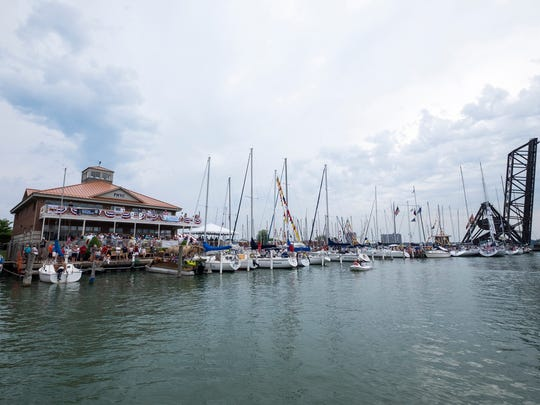 Spectators fill the patios behind the Port Huron Yacht Club as ships head for the Bell's Beer Bayview Mackinac Race Saturday, July 14, 2018 on Lake Huron.