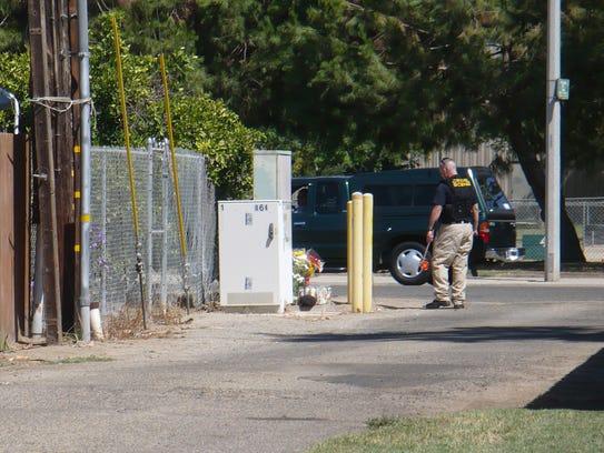 Tulare Evidence Technician Gary Coffman walks by a