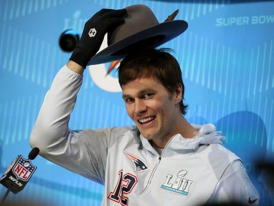 New England Patriots quarterback Tom Brady (12) puts