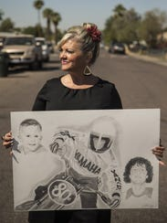 Toinette Benson stands on the corner of Palm Lane and
