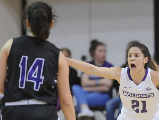 ACU's Kayla Galindo, right, defends against Stephen