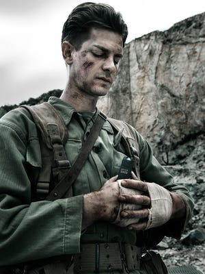 """Desmond Doss (Andrew Garfield) is a devout member of the Seventh-day Adventist Church in """"Hacksaw Ridge."""""""
