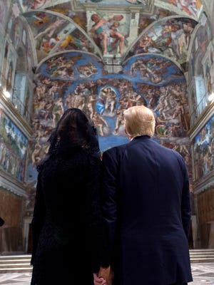 President Donald Trump and his wife, Melania, look at the frescoed ceilings during their visit to the Sistine Chapel at the Vatican, Wednesday, May 24, 2017.