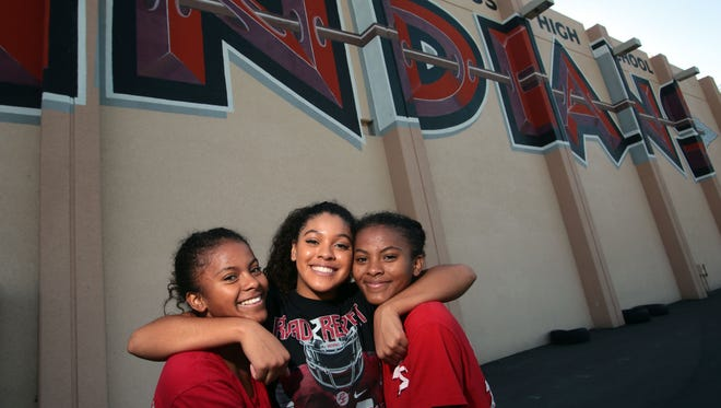 Sisters Hannah Wright, center, Maribel Wright, right, and Marisela Wright on Friday at Palm Springs High School. All three play volleyball for Palm Springs High.