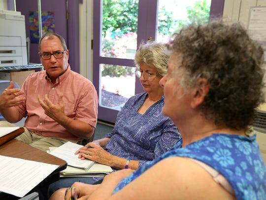 Don Hudgins, the new director of special events for the Salem Art Association, speaks with Leslie Coleman Zeigen, right, and Eileen Cooter Howell during a Salem Art Fair and Festival committee meeting July 8 at the Bush Barn Art Center.