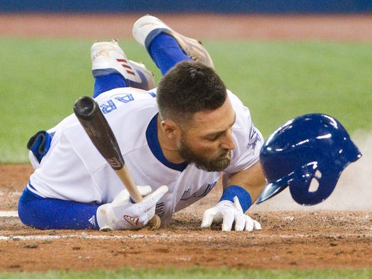 Toronto Blue Jays' Kevin Pillar hits the ground after being hit by a pitch from Boston Red Sox starting pitcher Joe Kelly during the fourth inning of a baseball game Friday, April 8, 2016, in Toronto. (Fred Thornhill/The Canadian Press via AP)