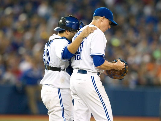 Toronto Blue Jays catcher Dioner Navarro goes out to talk to pitcher Aaron Sanchez after the gave up a home run to Baltimore Orioles' Chris Davis during fifth inning AL baseball game action in Toronto Tuesday Aug. 5, 2014. (AP Photo/The Canadian Press, Fred Thornhill)