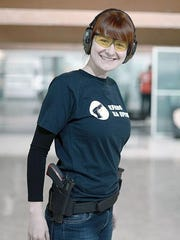 Maria Butina attends a shooting training of members