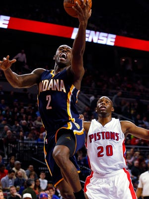 Indiana Pacers guard Rodney Stuckey (2) drives against Detroit Pistons guard Jodie Meeks on Dec. 26, 2014.