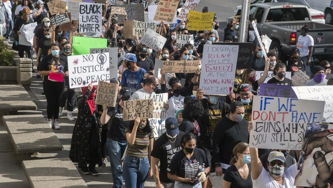Demonstrators march June 1 down Center Street in downtown Stockton to protest  the death of George Floyd.