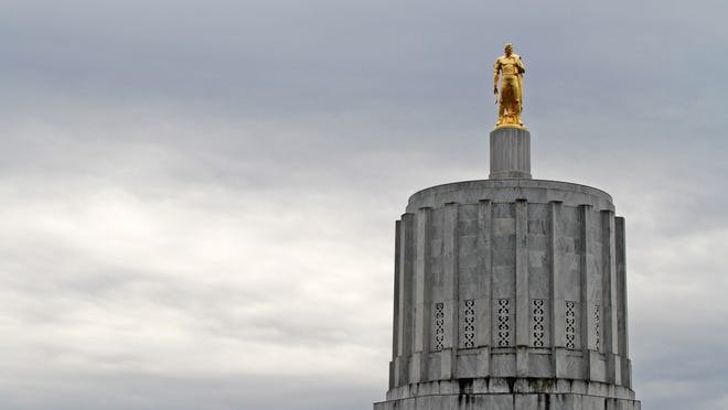 The Golden Pioneer or gold man is seen atop the Capitol.